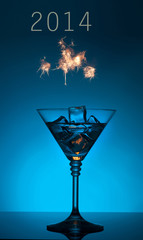 New year 2014 cocktail on blue background