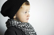 fashionable little boy in scarf and cap.winter style children