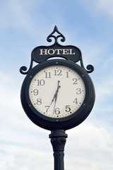 Clock with hotel sign in Victorian-style