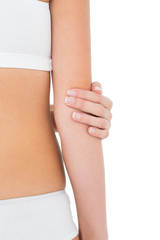 Close-up mid section of a fit woman with elbow pain