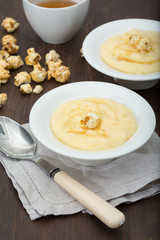 polenta with milk,sweet syrup and popcorn
