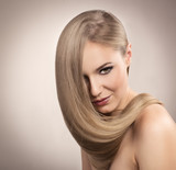 Hair care. Portrait of blond woman with shiny hairstyle