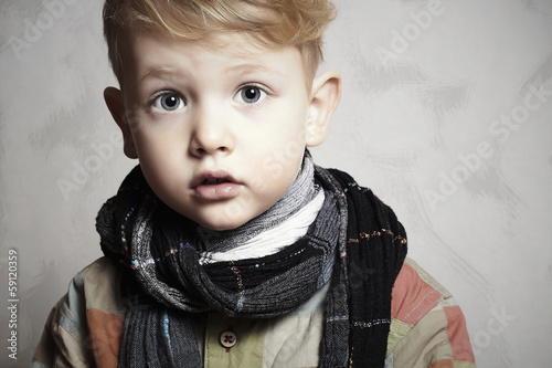 fashion handsome little boy in scarf.grunge background.haircut