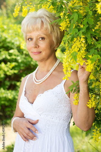 Beautiful adult woman with flowers