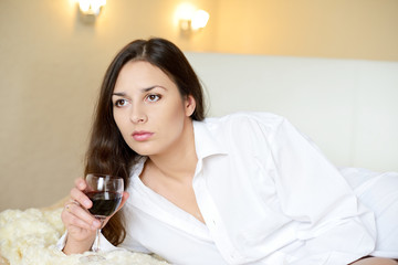brunette with glass of wine