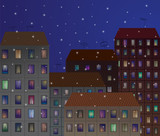 City at night with falling snowflakes.