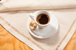 Cup of Coffee on the white napkin