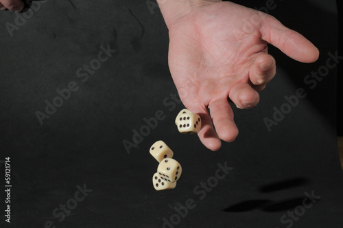 One Left Male Hand Playing Dice