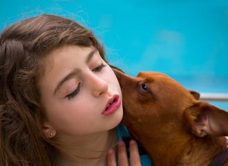 Brunette kid girl and dog pet whispering ear