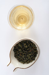 Oolong tea  leaves with a pot
