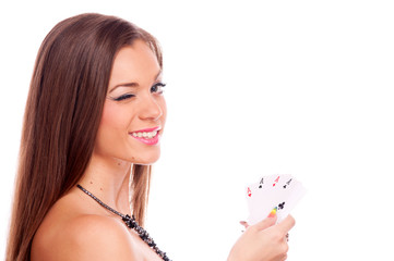 Brunette with poker of aces winking