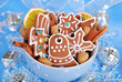 bowl of homemade christmas gingerbread cookies on blue backgroun