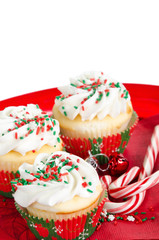 Holiday cupcakes with vanilla frosting, red and green sprinkles
