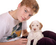 Junge mit Lagotto Romagnolo Welpe