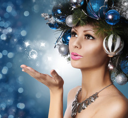 Christmas Woman with Decorated Hairstyle Blowing Kiss.