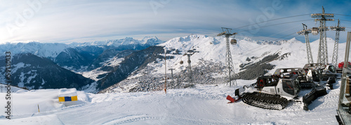Panoramic view of the Pyrenees and snow plow trucks