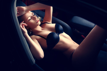 Sexy woman in car