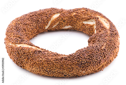 Turkish bagel called simit isolated on white