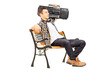 Guy holding a boombox on his shoulder and sitting on a wooden be