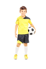 Full length portrait of a kid in sportswear with a soccer ball