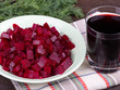 Fresh segments of a beet and beetroot juice