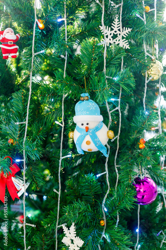 christmas toy on green pine tree