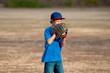 Cute young boy playing baseball outdoors