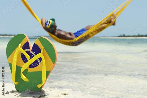 Man Relaxes in Hammock on Brazilian Beach