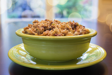 Turkey Stuffing in Green Bowl with Bokeh Background