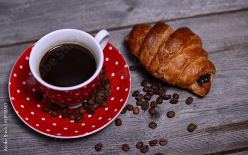 Coffee and croissant on wooden