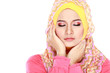 Fashion portrait of young beautiful muslim woman with pink costu