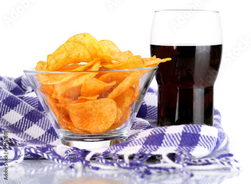 Chips in bowl, cola and TV remote on plaid isolated on white