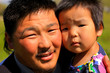 Mongolian man posing with his daughter - 59141564