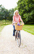 Middle Aged Woman Enjoying Country Cycle Ride
