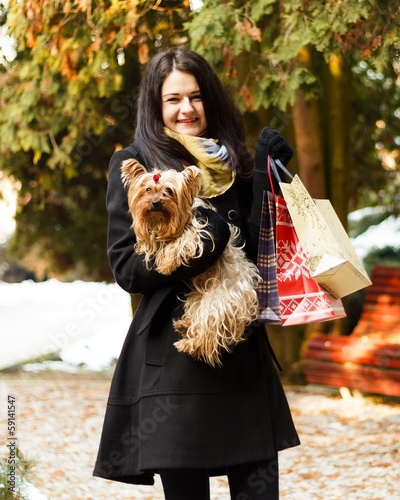 Stylish dog with owner gone shopping