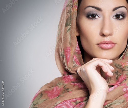 Portrait of a young and beautiful woman wearing scarf