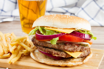 Big burger with french fries and beer