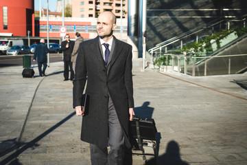 successful elegant fashionable businessman using tablet