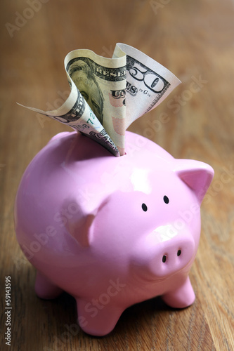 .Stuffed piggy bank with US dollars