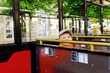 Cute little boy riding in a bus or tram