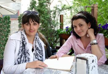 Two women having a meeting outdoors