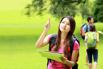 curious asian girl camping in the park