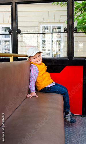 Little boy sitting alone in a bus