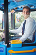 Portrait Of Bus Driver Behind Wheel - 59144769