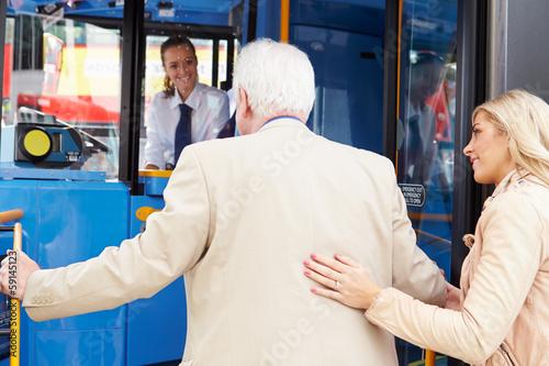 Woman Helping Senior Man To Board Bus - 59145123