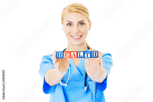 Nurse Holding Blocks Spelling Out Health Over White Background