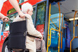 Senior Couple Boarding Bus Using Wheelchair Access Ramp - 59145331