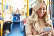Leinwanddruck Bild - Woman Reading Text Message On Bus