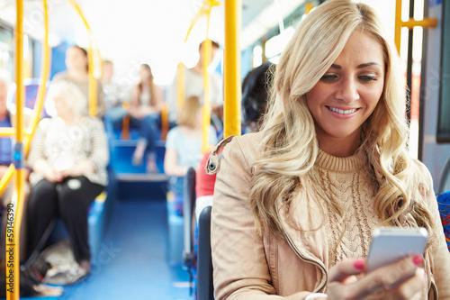 Leinwanddruck Bild Woman Reading Text Message On Bus
