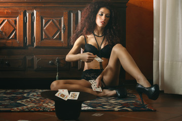 Bored lingerie model with playing cards